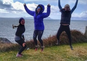 Happy Eigg Run Club, with Eigg in the background
